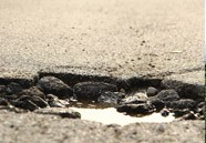 Potholes patched with recycled shingles